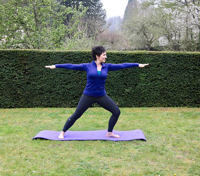 Janice doing yoga in her garden